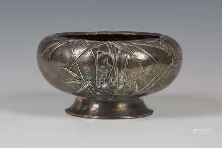 A Chinese silver bowl, early 20th century, the compressed circular body worked in relief with bamboo