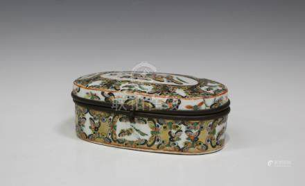 A Chinese Canton porcelain oval box and hinged cover, late 19th century, with gilt metal mounts, the
