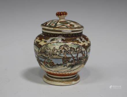 A Japanese Satsuma earthenware pot and cover, Meiji period, the compressed globular body painted and