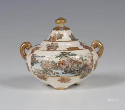A Japanese Satsuma earthenware jar and domed cover by Kinkozan, Meiji period, the squat globular