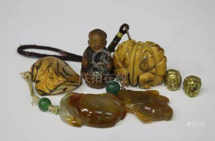 Two Chinese agate pendants, late Qing dynasty, each carved and pierced in the form of fruit and