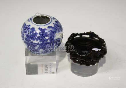 A Chinese blue and white porcelain globular water coupe, late Qing dynasty, painted with various