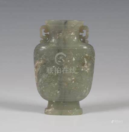 A Chinese celadon green jade vase, Qing dynasty, the well-hollowed flattened spade-shaped body