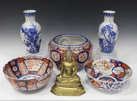 A Japanese Imari porcelain jardinière, Meiji period, of faceted bulbous form, painted with floral