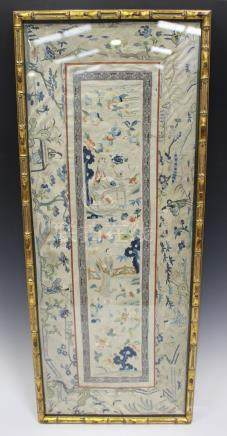 A Chinese silk embroidered sleeve panel, late 19th century, worked in coloured threads with two