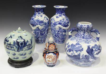 A pair of Japanese Arita blue and white porcelain vases, Meiji period, each baluster body painted