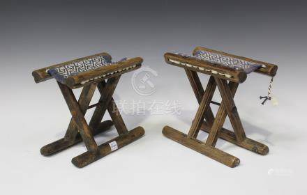 A pair of Chinese provincial elm folding stands, late Qing dynasty, each 'X' frame supporting a
