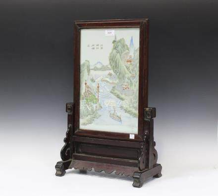 A Chinese stained wood and porcelain table screen and slotted stand, 20th century, the rectangular