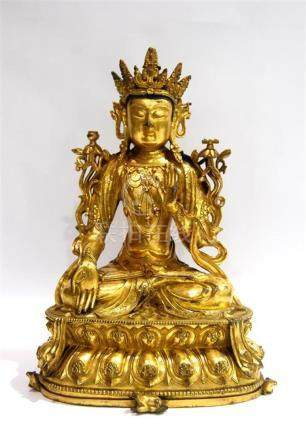 A Gilt Bronze Alloy of a Seated Manjushri, Elaborately Adorn