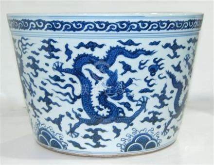 A Large Underglaze Blue Fish Bowl, Painted with Dragons Flyi