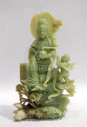 A Large Celadon Jade Guanyin, Seated in a posture of Royal E