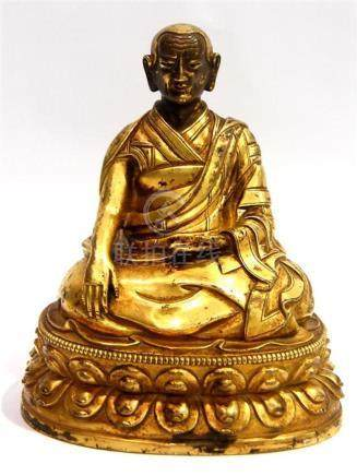 A Tibetan Gilt Bronze Alloy of a Senior Monk, Wearing Layere