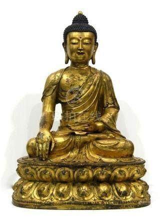 A Large Gilt Bronze Alloy of a Buddha, a Young Serene Full F