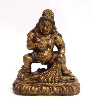 A Tibetan Gilt Bronze Alloy a Figure of a Black Jambhala, [K