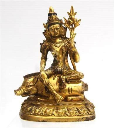 A Gilt Bronze Bodhisattva Seated on a Pig,