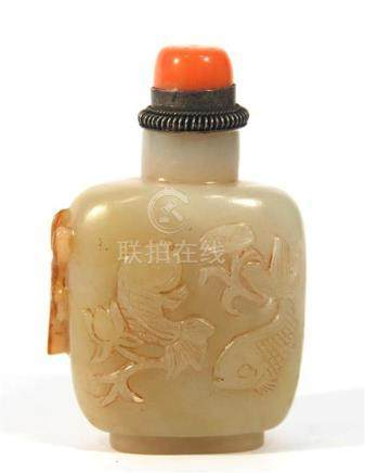 A Carved White Jade Snuff Bottle, with Fish Swimming in a Lo