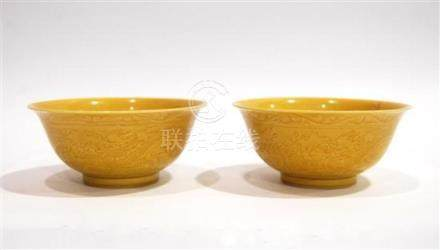 A Pair of Porcelain Bowls with an Amber Yellow Glaze, Incise