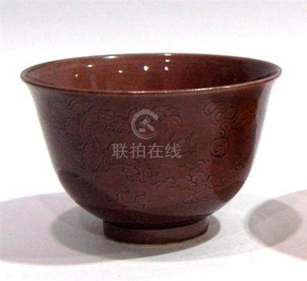 An Aubergine Glazed Tea Bowl, Incised with Two Flying Dragon