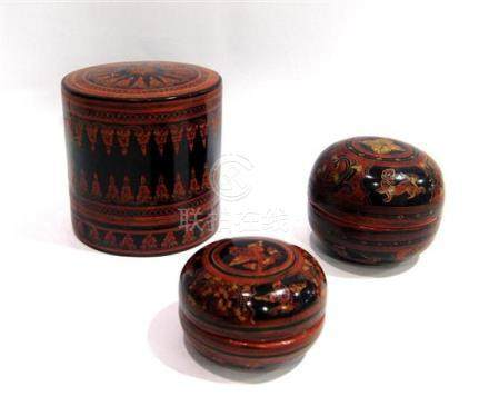 A Burmese Lacquered Box & Two Cushion Shape Graduating Cases