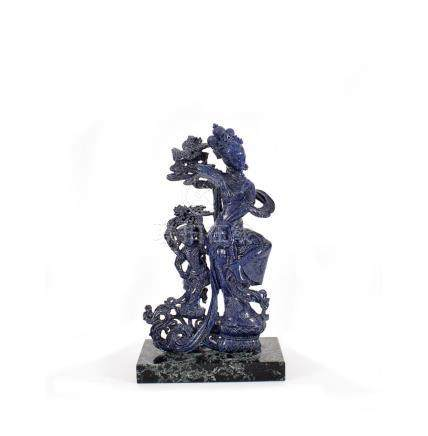 A Chinese lapis-lazuli sculpture of a dancing guanyin