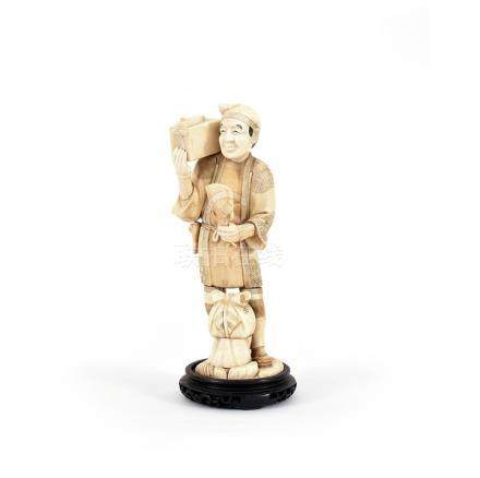 A Japanese ivory sculpture of a peasant man, Meiji period