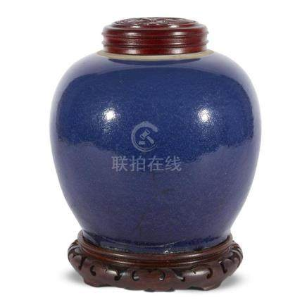 A Chinese dark blue-glazed porcelain ovoid jar with wood sta