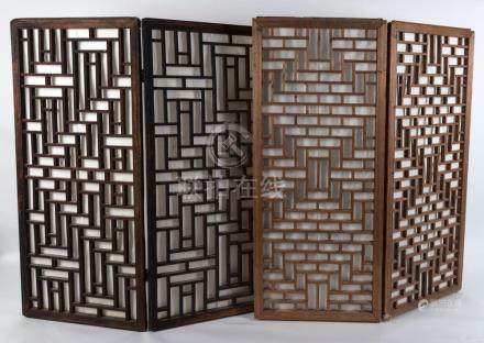 Two pairs of Chinese wooden window screen panels, 19th centu