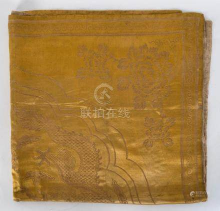 A Chinese embroidered yellow silk altar cloth with dragon mo