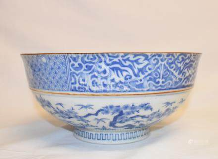 A Chinese porcelain bowl, decorated a figure and foliage, 22 cm diameter