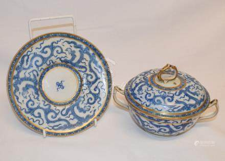 A Chinese porcelain bowl and cover, with stand, decorated dragons, a pair of vases, with Imari