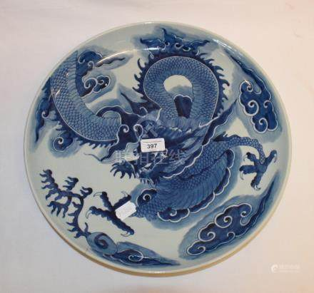 A Chinese charger, decorated a dragon in the clouds in underglaze blue, rim crack, 39.5 cm diameter