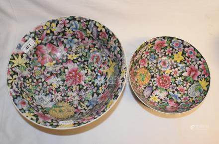 A matched set of four Chinese porcelain millefleurs bowls, on pierced hardwood stands, the largest