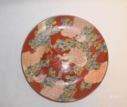 A Japanese Imari plate, decorated a dragon in the clouds, 30.5 cm diameter, and seven other Japanese