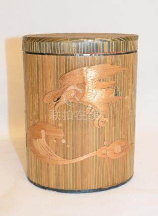 A Kwangtung Arts and Crafts straw work box and cover, decorated a bird and waves, 14.5 cm high, a