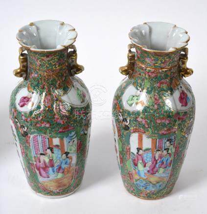 A pair of late 19th century Cantonese famille rose vases, the neck in the form of tied and