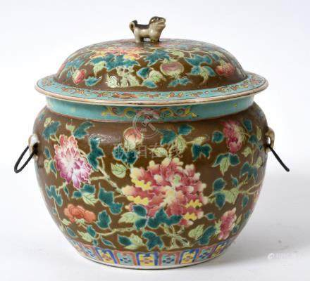 A Chinese famille rose bowl and cover, decorated flowers and foliage on a batavia ground, the