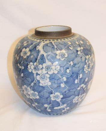 A Chinese porcelain bowl, decorated foliage on a blue ground, cracked, 22 cm diameter, a similar