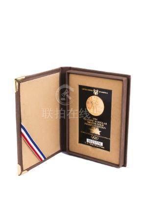 Médaille olympique en or,10 dollars, 1984.Dans son écrin d'origine.Diam.: 2,7