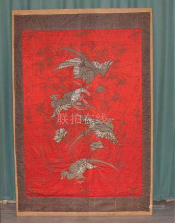 An early 20th century Chinese wirework and embroidered panel, decorated four exotic birds and