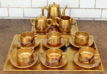 A modern Chinese lacquered 17 piece tea set, comprising tray, tea cups and saucers decorated with