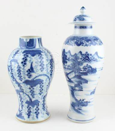 Two 18th century Chinese blue and white vases, one is slender baluster form with knop lid and of