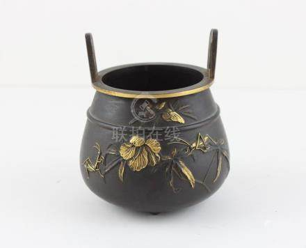 A Japanese Meiji period twin handled bronze Koro with gilt decoration