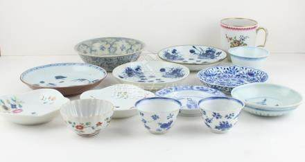 A fourteen piece collection of predominantly Chinese late 17th century and 18th century porcelain