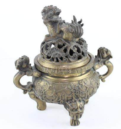 A Chinese lacquered twin handled brass censor and cover, with greek key decoration, the sides with
