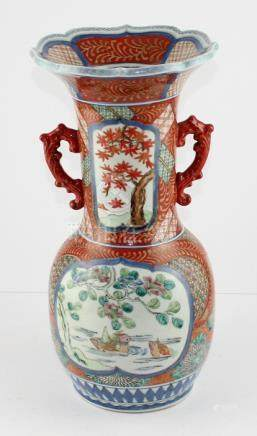 A late 19th century Japanese Meiji Period Imari twin handled vase decorated in typical palette with