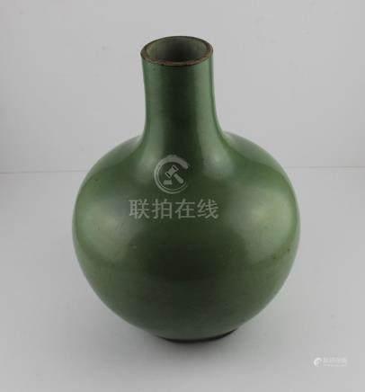 A 19th century Chinese bulbous porcelain monochrome vase,with celadon glaze,, 30 cm high