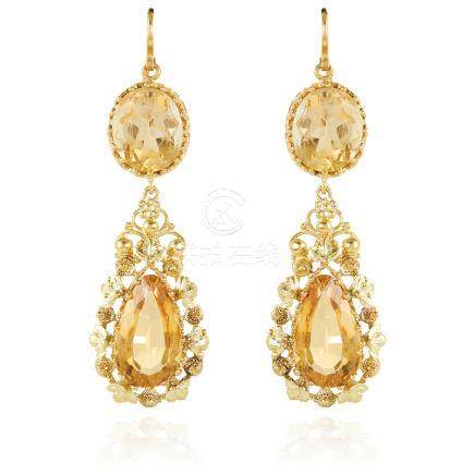 A PAIR OF ANTIQUE CITRINE EARRINGS in high carat yellow gold, each set with an oval cut citrine