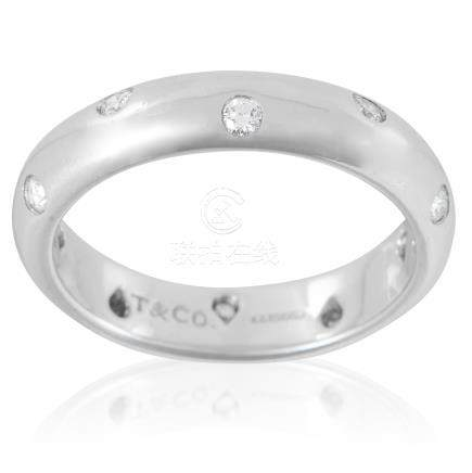 AN ETOILE DIAMOND ETERNITY RING, TIFFANY & CO in platinum, the plain, bevelled band set with ten