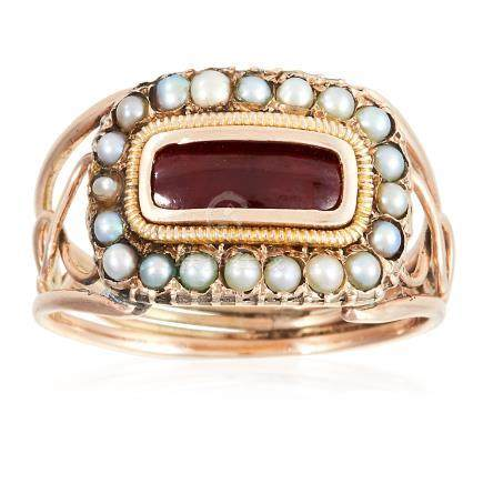 AN ANTIQUE GARNET AND SEED PEARL MOURNING RING, CIRCA 1830 in high carat yellow gold, set with an