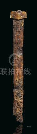A BROWN JADE SWORD GUARD AND IRON SWORD